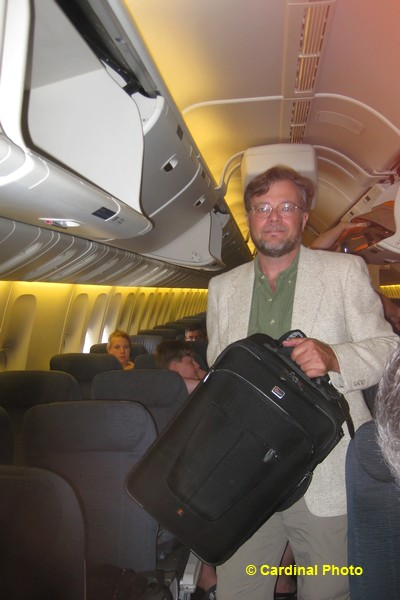 David puts the Lowepro X200 into an overhead compartment